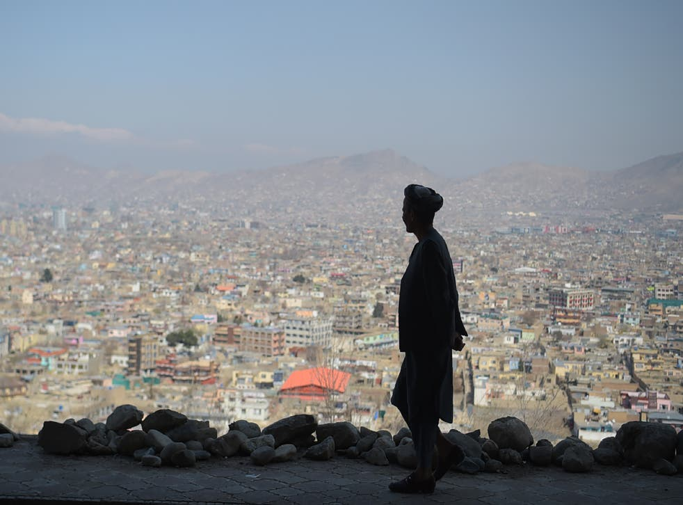 <p>An Afghan man walks during the first day of the Nowruz (Noruz), or Persian New Year, in a hilltop overlooking of Kabul on March 21, 2018.</p>
