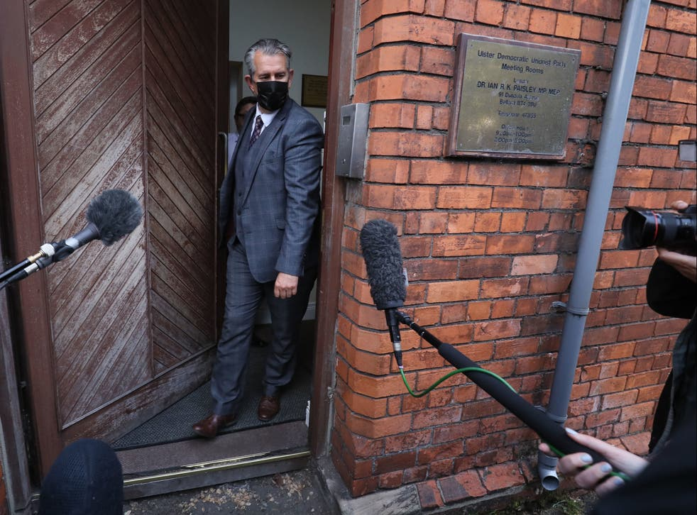 <p>Edwin Poots leaves the DUP headquarters in Belfast on Thursday, prior to standing down as the party leader following an internal party revolt against him</p>