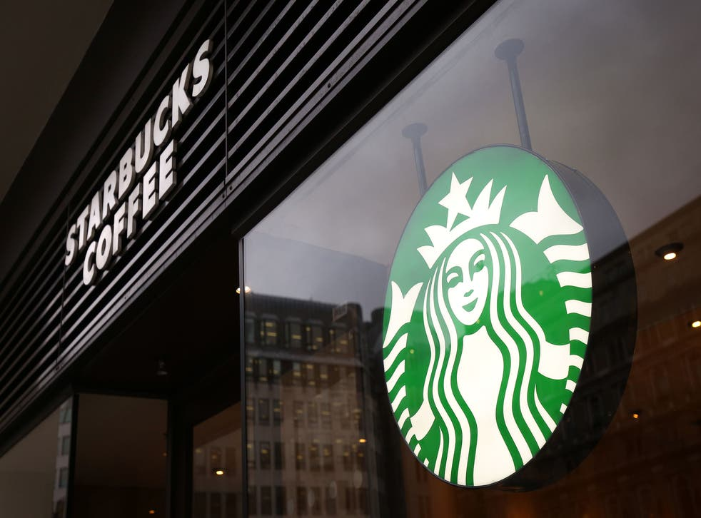 <p>Starbucks sued by worker who claims company did not protect him from racial abuse from a customer</p>