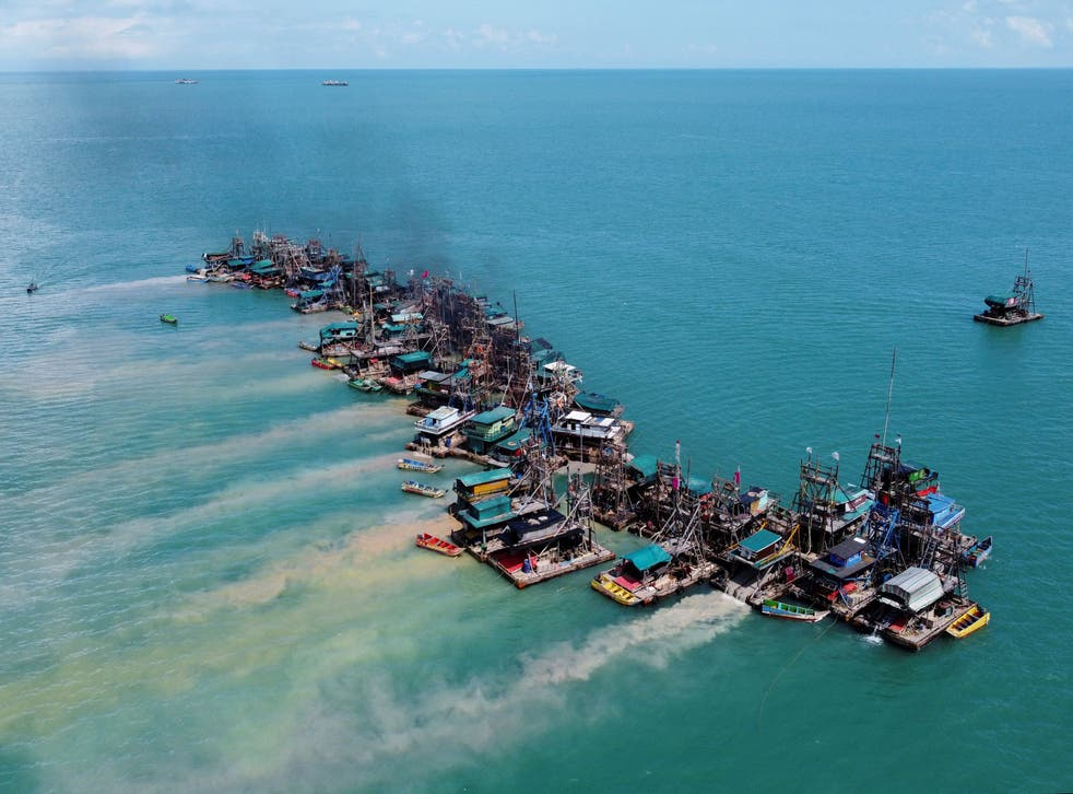 <p>Wooden pontoons equipped to dredge the seabed for deposits of tin ore off the coast of Toboali, Indonesia</p>