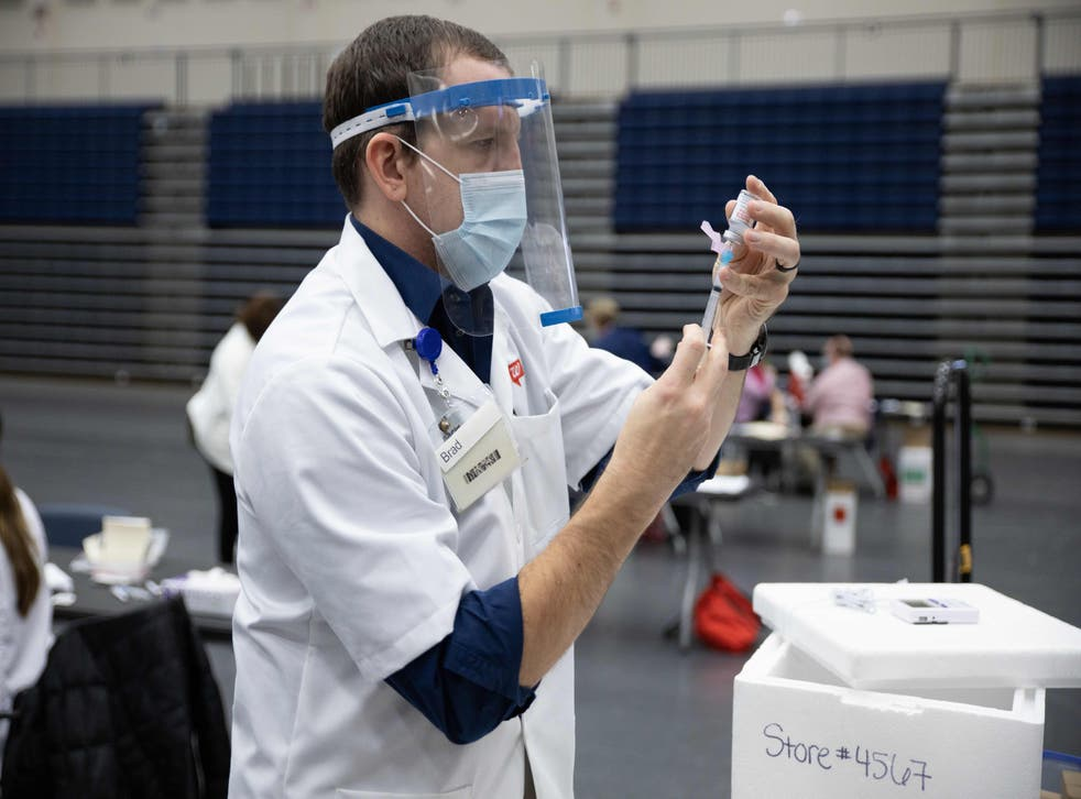 <p>Walgreens staff prepare vaccines for educational staff at Kettering City Schools to receive the Covid-19 vaccine as a part of Ohio's Phase 1B vaccine distribution in Dayton, Ohio on 10 February 2021</p>