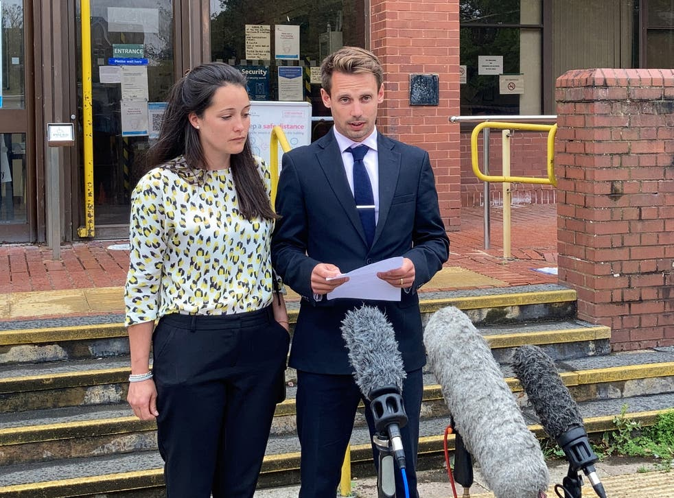 <p>Tom and Sarah Richford read a statement outside Folkestone Magistrates' Court</p>
