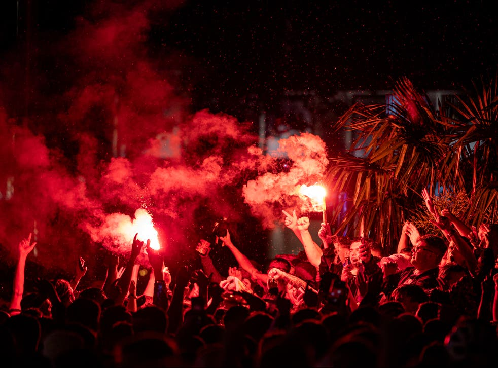 <p>Scotland fans let off flares in Leicester Square after the England v Scotland game ended 0-0</p>