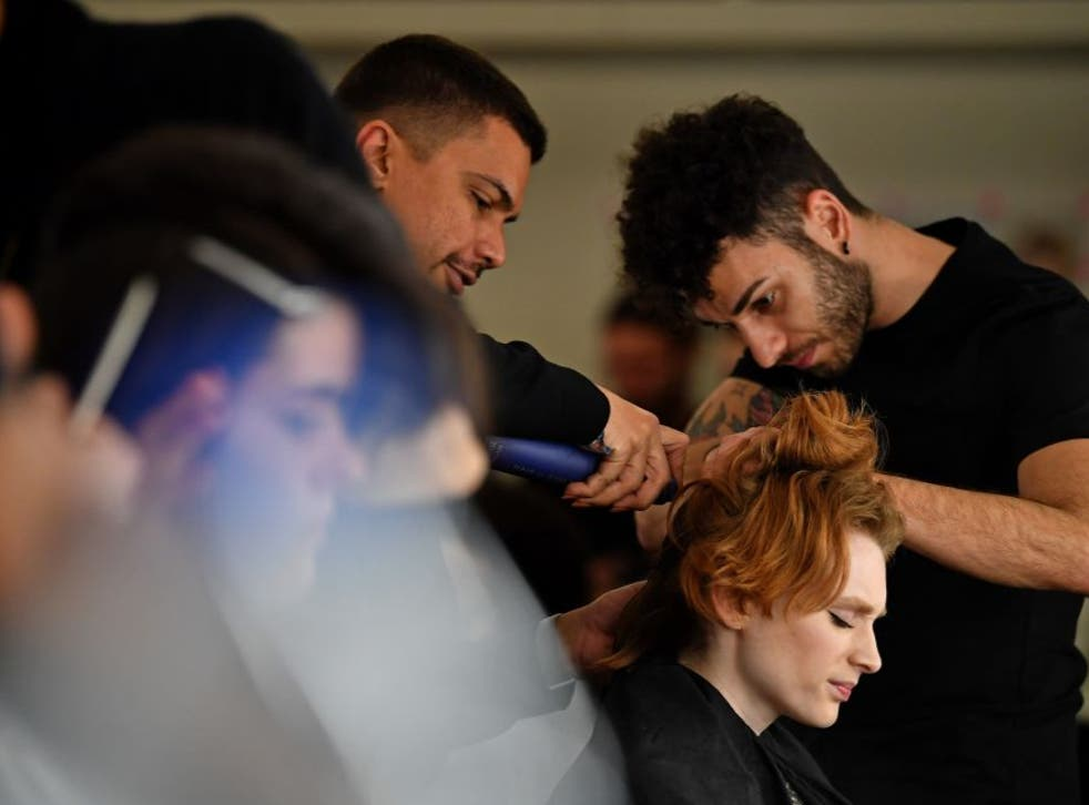 <p>Models have their hair and make-up prepared before presenting creations by fashion house Richard Quinn during the catwalk show for their Autumn/Winter 2020 collection on the second day of London Fashion Week in London</p>