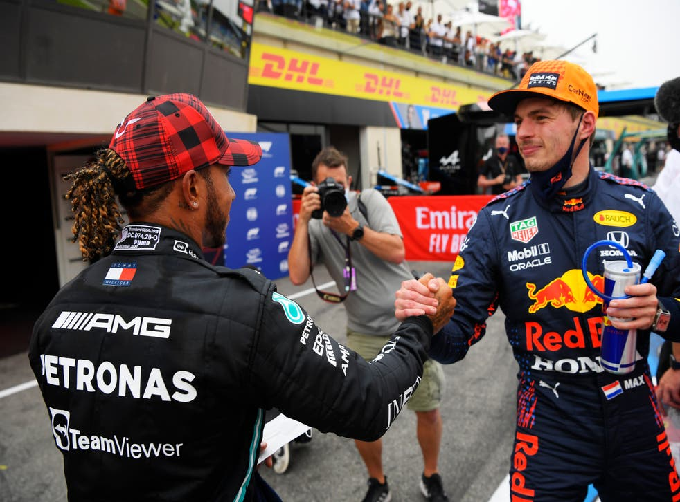 <p>Max Verstappen is congratulated by Lewis Hamilton</p>