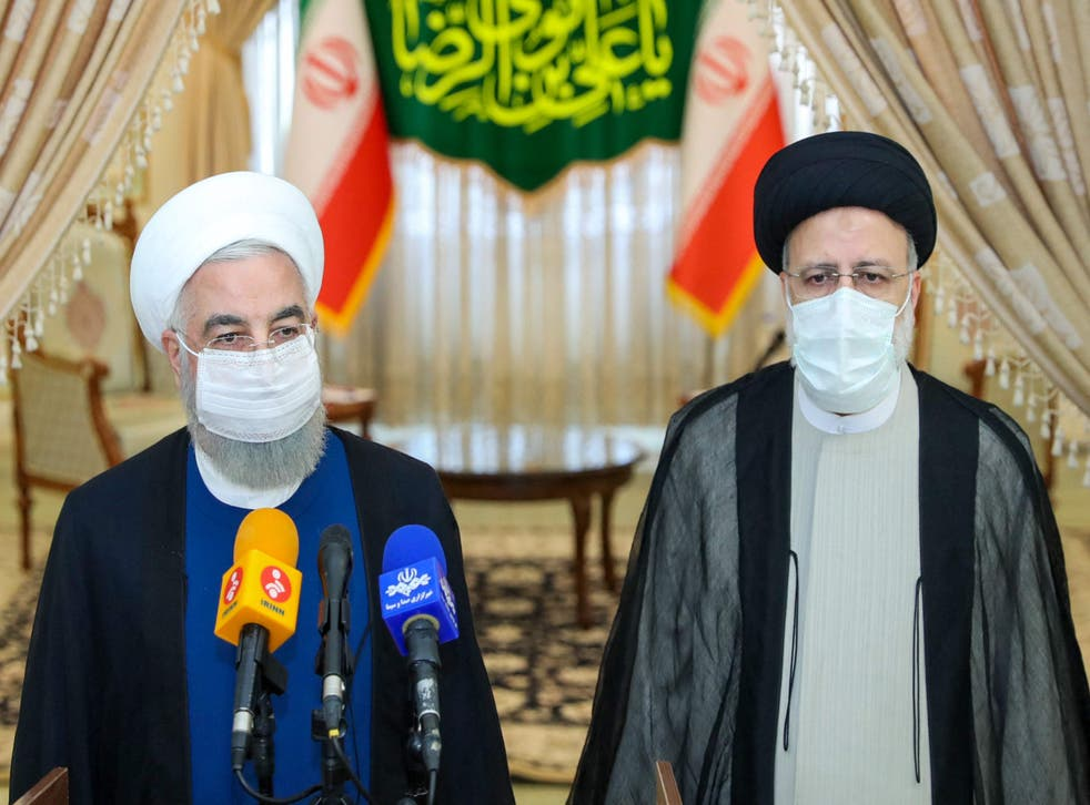 <p>Outgoing president Hassan Rouhani (L) takes part in a press conference with president-elect Ebrahim Raisi </p>