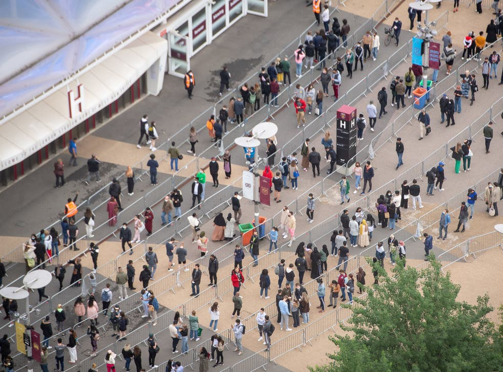 <p>Long queues formed outside an NHS vaccination clinic at West Ham's London Stadium in Stratford, east London</p>