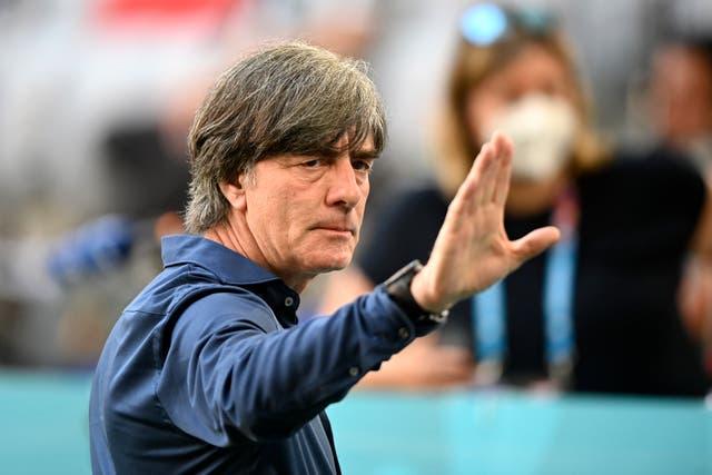 Germany coach Joachim Low gestures towards fans