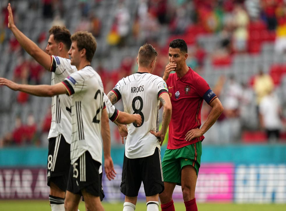Portugal's Cristiano Ronaldo (right) talks to Germany's Toni Kroos after the Euro 2020 match in Munich