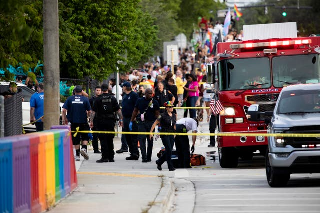 <p>Police and firefighters respond after a truck drove into a crowd of people during The Stonewall Pride Parade and Street Festival in Wilton Manors, Fla., on Saturday, June 19, 2021</p>
