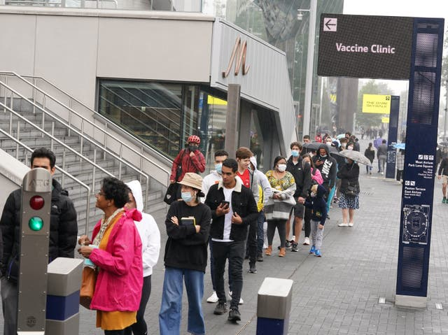 <p>Thousands more people queued up outside vaccination centres on Sunday</p>