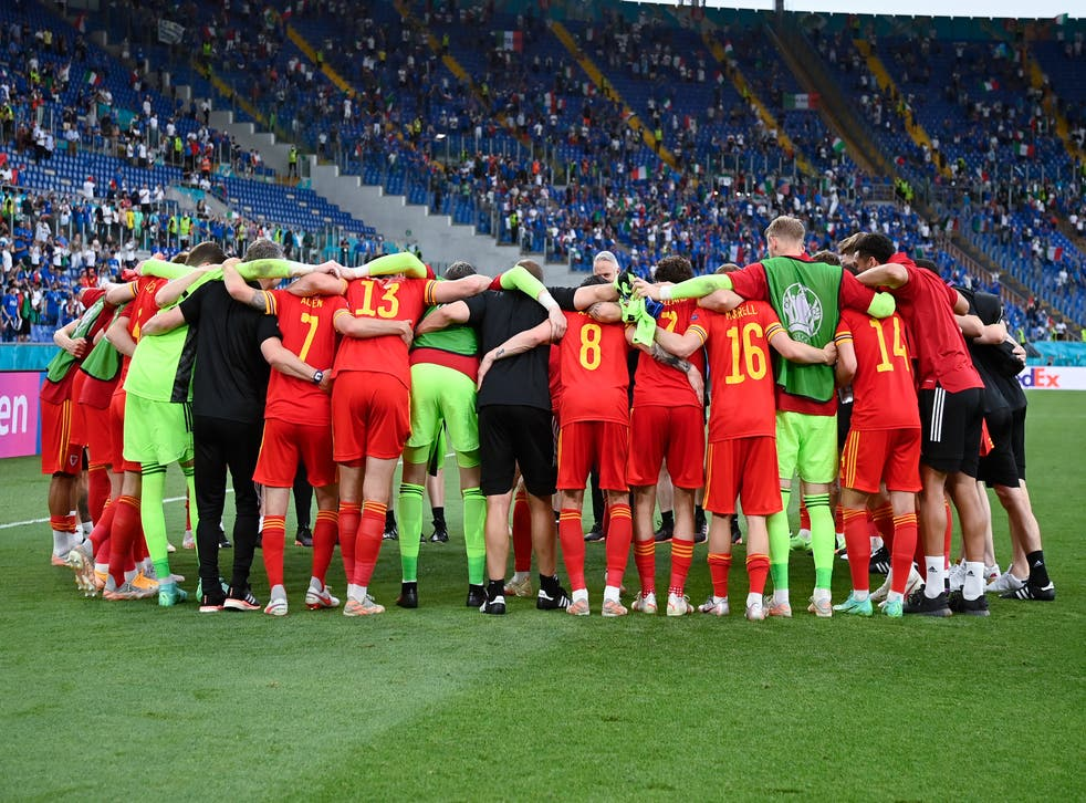 Wales reflect on their progress to the last 16 at Euro 2020 in a post-match huddle after their defeat to Italy