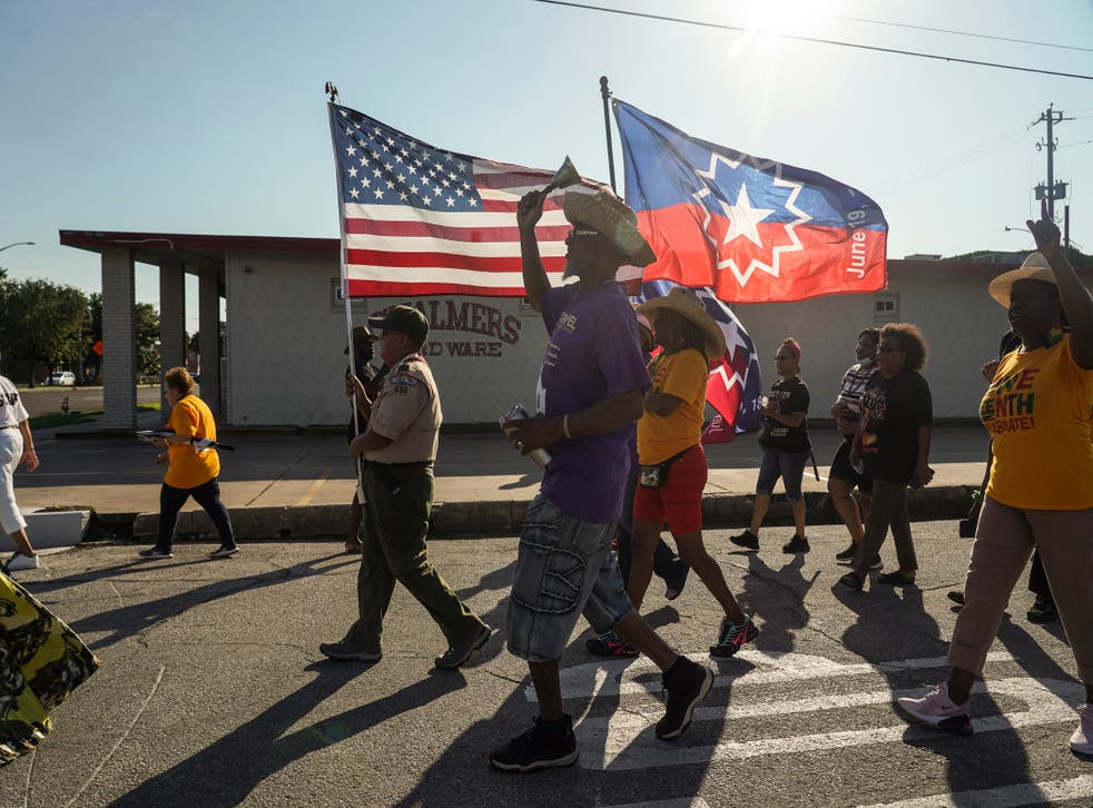 <p>19 June: Members of Reedy Chapel African Methodist Episcopal Church march to celebrate Juneteenth on 19 June 2021 in Galveston, Texas</p>