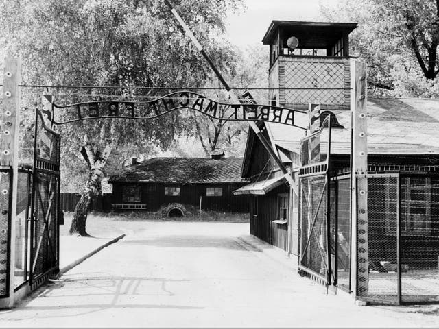 """<p>A picture taken in April 1945 depicts Auschwitz concentration camp gate, with the inscription """"Arbeit macht frei"""", after its liberation by Soviet troops in January 1945.</p>"""