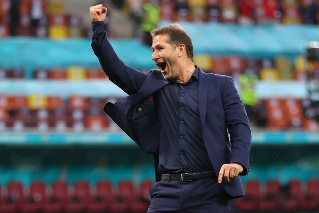 <p>Franco Foda celebrates Austria's win over Ukraine</p>