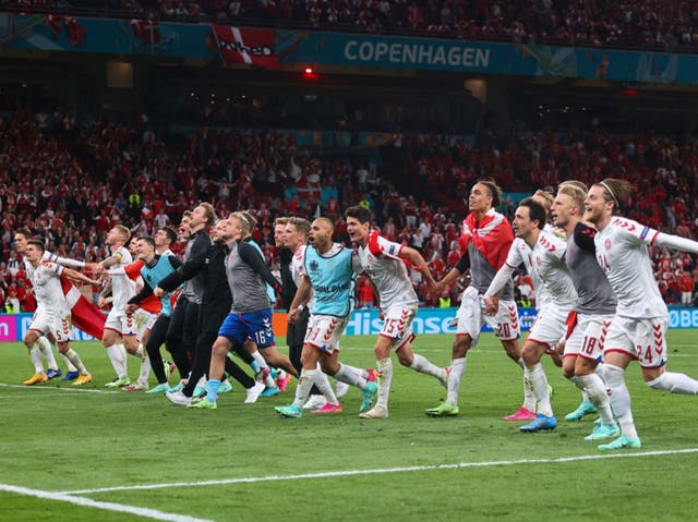 <p>Denmark celebrate in front of their fans</p>