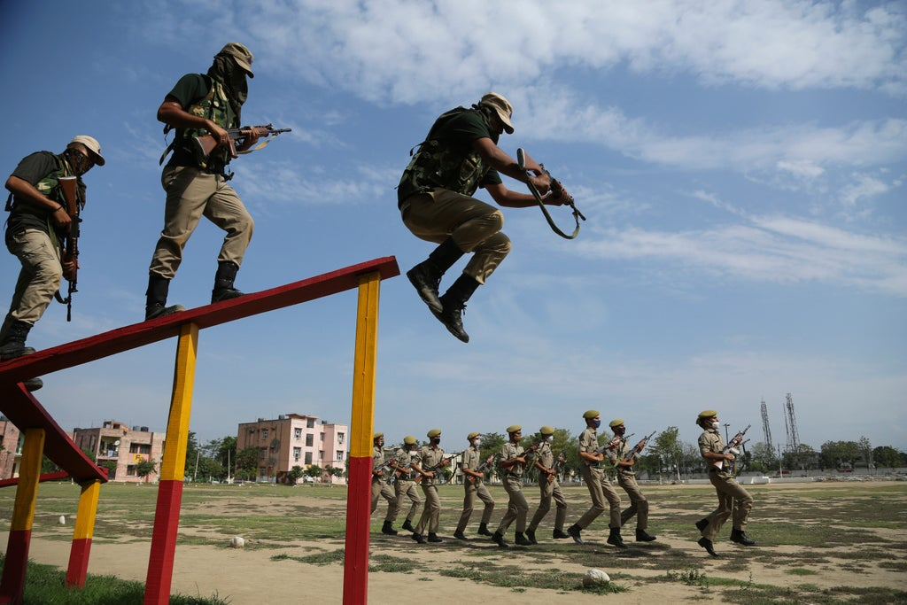 AP PHOTOS: Indian police train villagers for border security