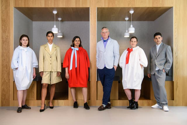 <p>Giles Deacon (third from right) with models wearing the future of office wear by Giles Deacon for IWG</p>