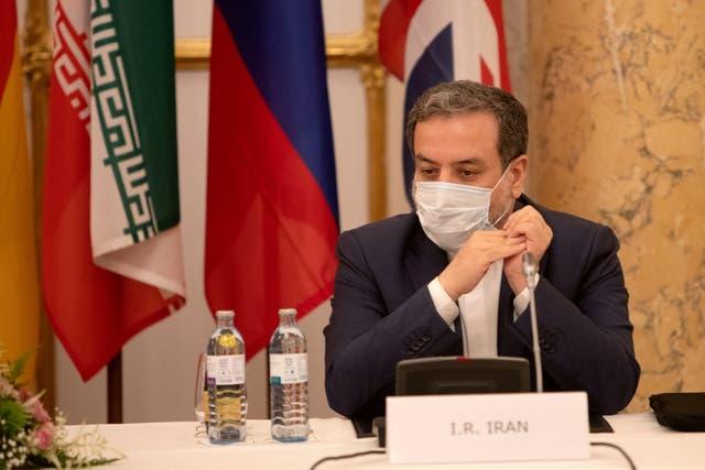 <p>Iran's top nuclear negotiator Abbas Araqchi in a meeting in Vienna</p>