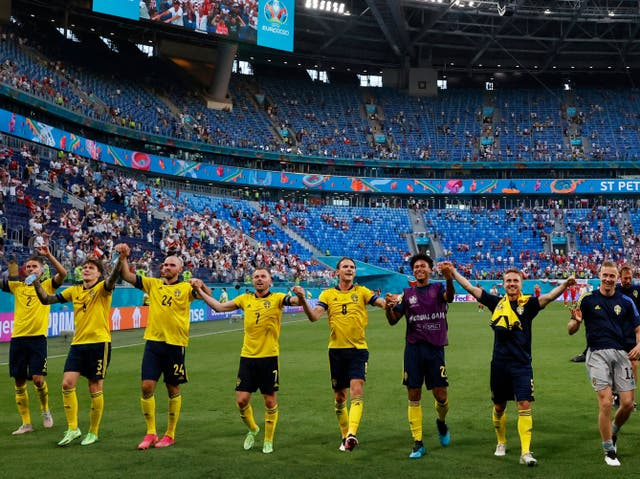 <p>Sweden players celebrate at full-time after finishing with seven points</p>