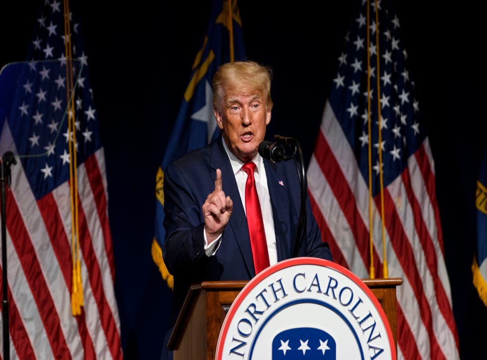 <p>Former US President Donald Trump addresses the NCGOP state convention on June 5, 2021 in Greenville, North Carolina. Mr Trump has sought to claim credit for Vice President Kamala Harris's plans to visit the US-Mexico border.</p>