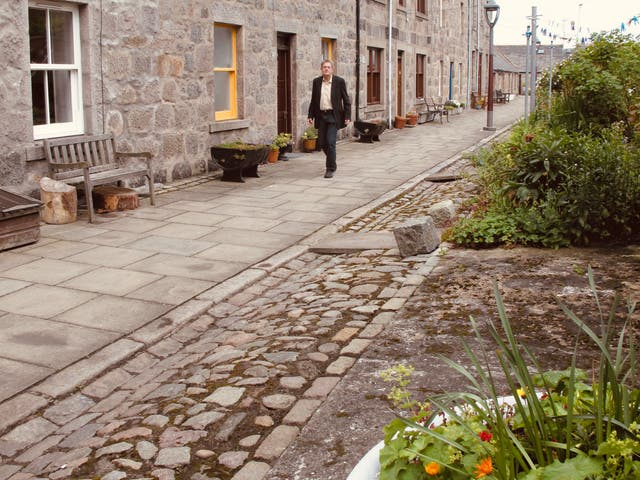 <p>On manoeuvres: Simon Calder in Footdee, Aberdeen</p>