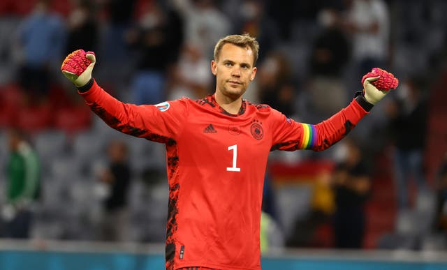 <p>Manuel Neuer wearing a rainbow armband during Germany's 2-2 draw with Hungary on Wednesday (Kai Pfaffenbach/AP).</p>