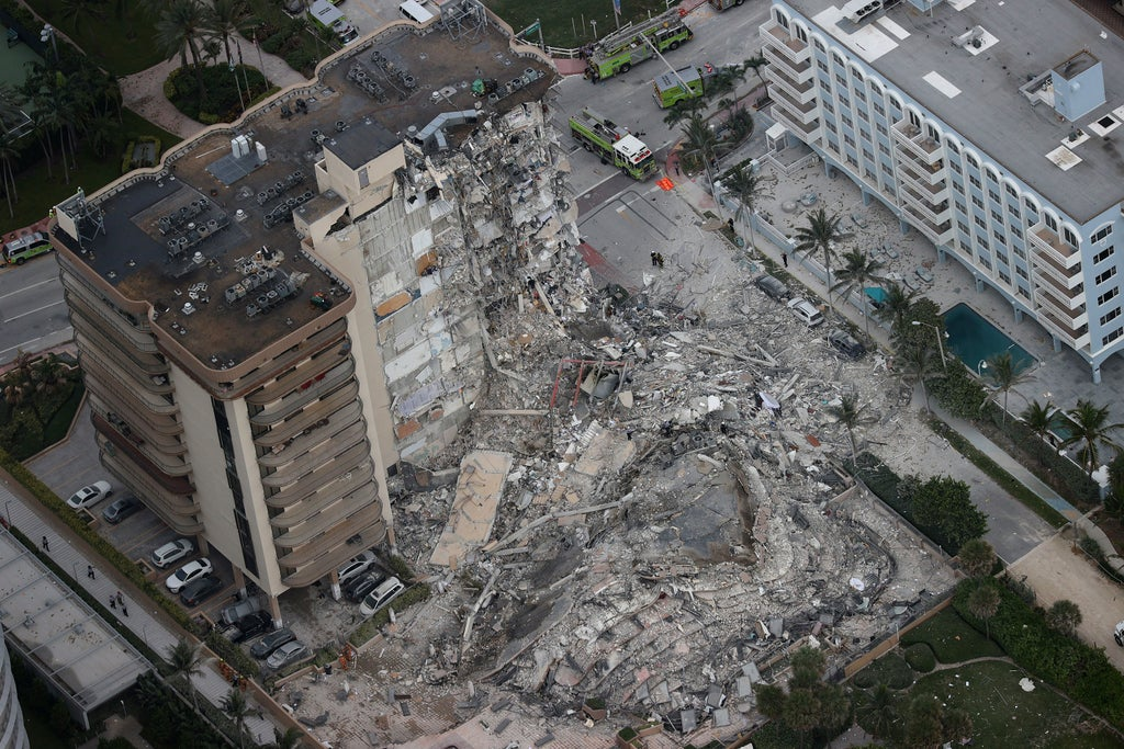Miami building collapse: Rescuers say they can hear 'what sounds like banging' as they search for missing 99