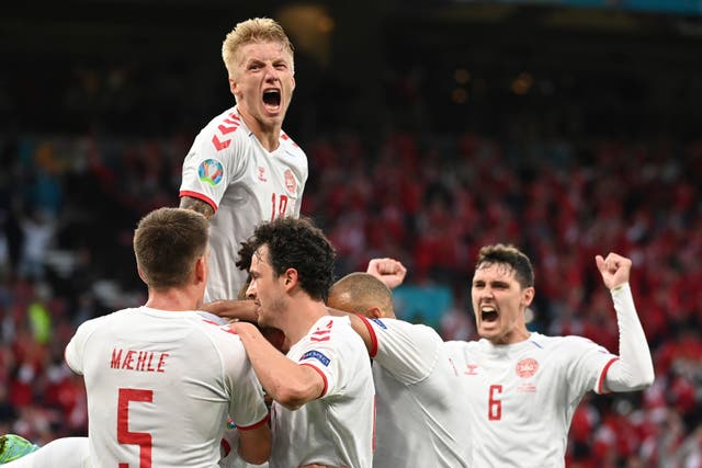 Denmark players celebrating scoring in their 4-1 Euro 2020 victory over Russia