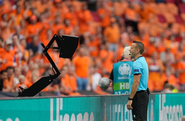 Israeli referee Orel Grinfeld checks the monitor and subsequently awards Holland a penalty against Austria