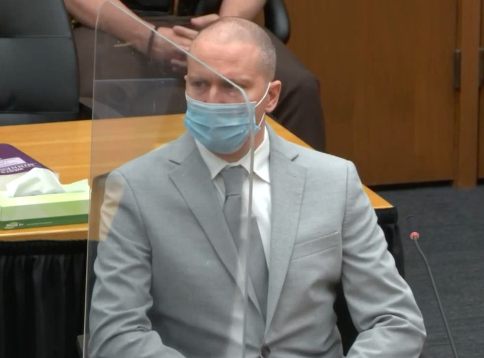 <p>Derek Chauvin listens to his mother's statement during his sentencing for the murder of George Floyd</p>