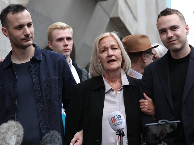 <p>Sally Challen, flanked by her sons James (left) and David, leaves the Old Bailey after hearing she will not face a retrial over the death of her husband Richard  in 2010</p>