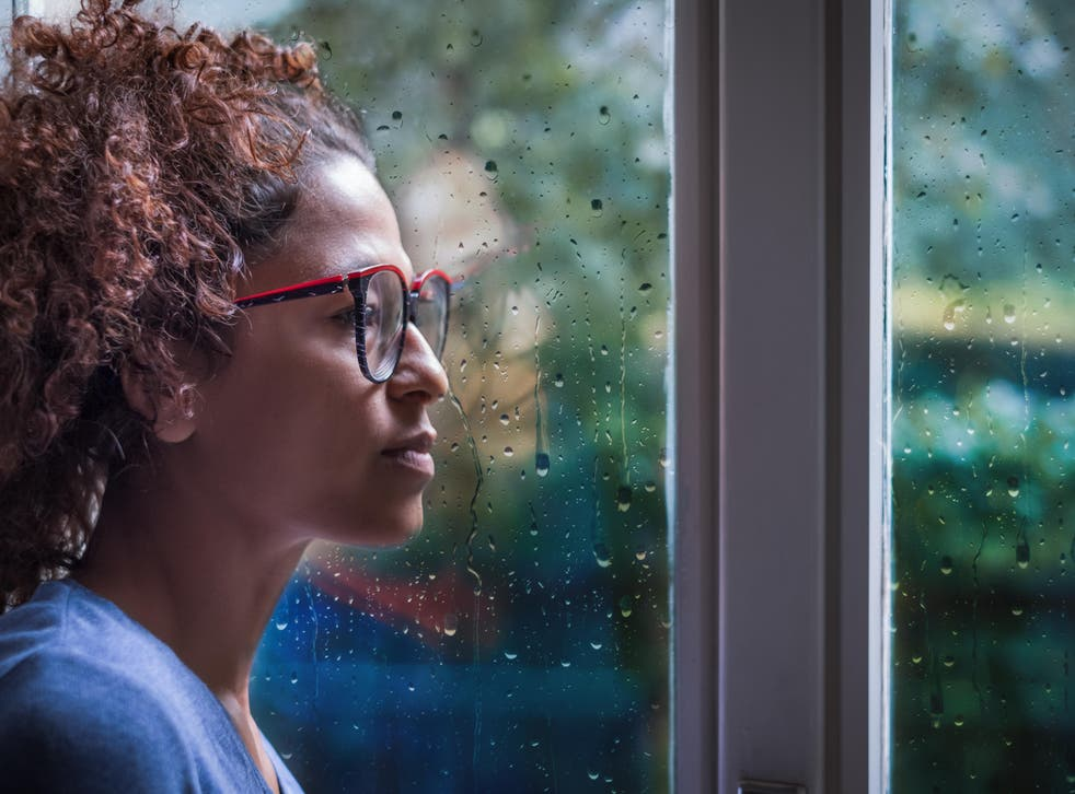 woman looking sadly out of window