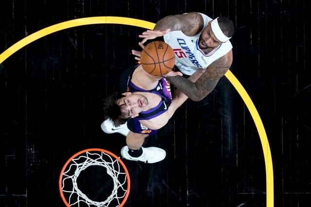 Los Angeles Clippers center DeMarcus Cousins (15) shoots over Phoenix Suns forward Dario Saric