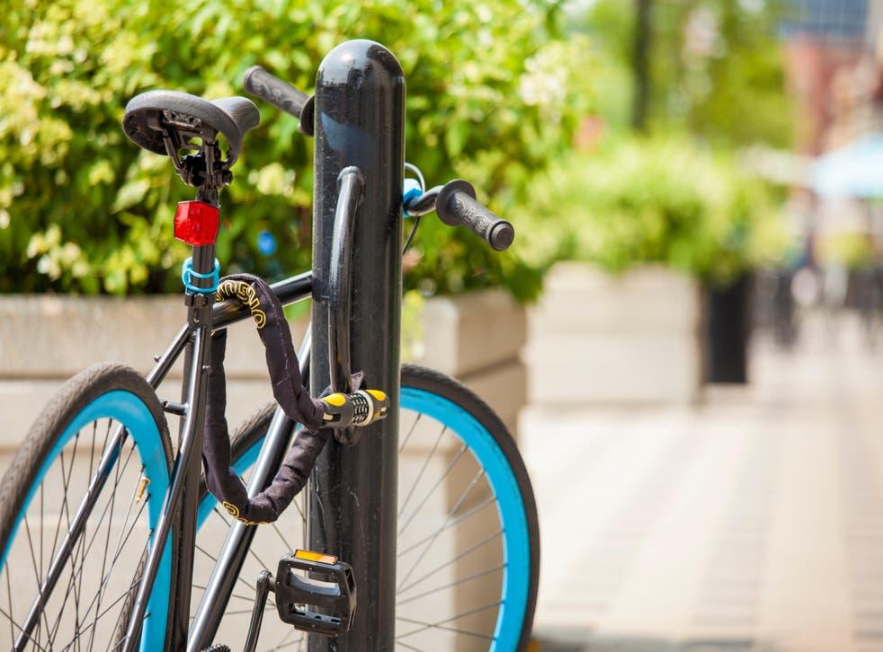bike locked on the sidewalk
