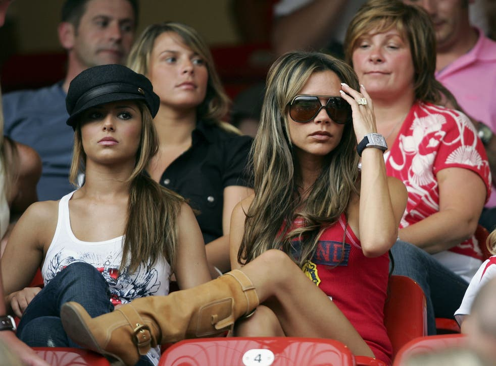 <p>Cheryl Tweedy and Victoria Beckham at the 2006 World Cup</p>