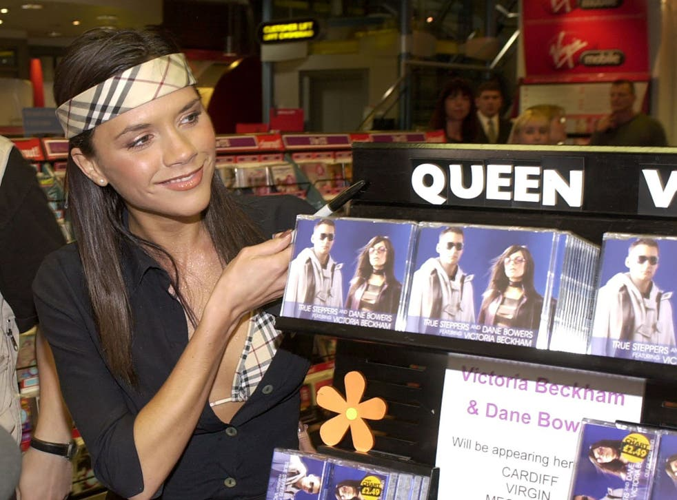<p>Queen Vic: Beckham promotes 'Out of Your Mind' at a Virgin Megastore in Cardiff in 2000</p>