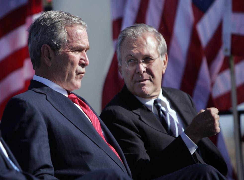 <p>Donald Rumsfeld with President George W Bush in 2006</p>