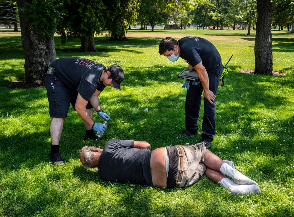 <p>EMTs in Spokane, Washington check on a resident amid extreme heat conditions</p>