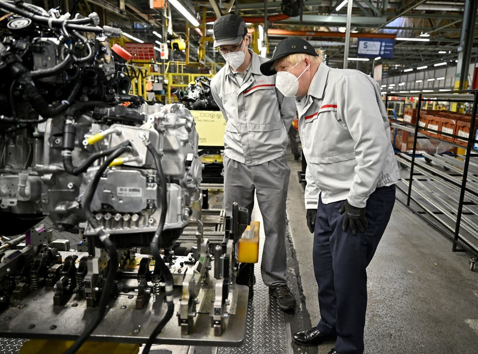 <p>Boris Johnson during his visit to the Nissan plant in Sunderland after its announcement</p>