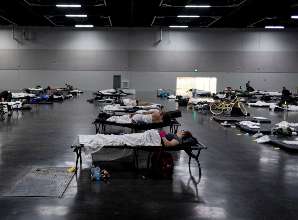 <p>People gather in a 'cooling centre' during Portland's record heatwave</p>