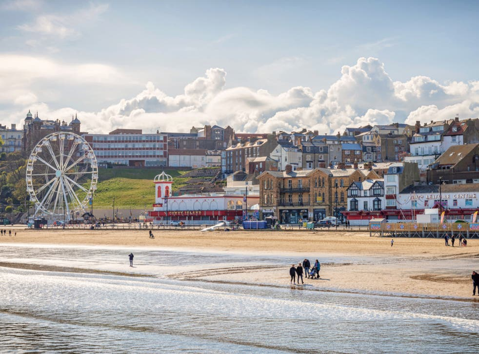 <p>People enjoying the beach at Scarborough in the sunshine</p>