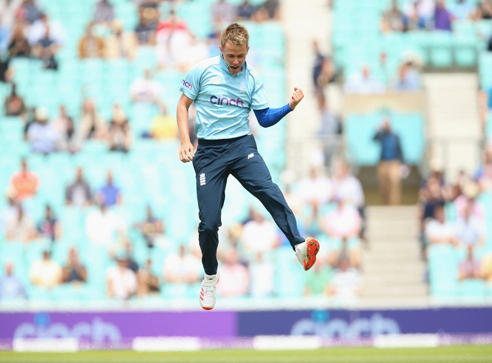 <p>England's Sam Curran celebrates one of his five wickets</p>