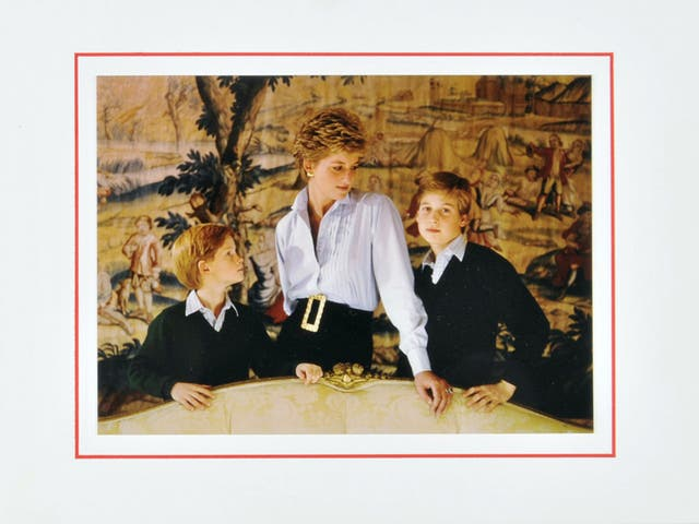 <p>A 1993 Christmas card sent from Diana featuring a photograph of the Princess with Princes William and Harry</p>