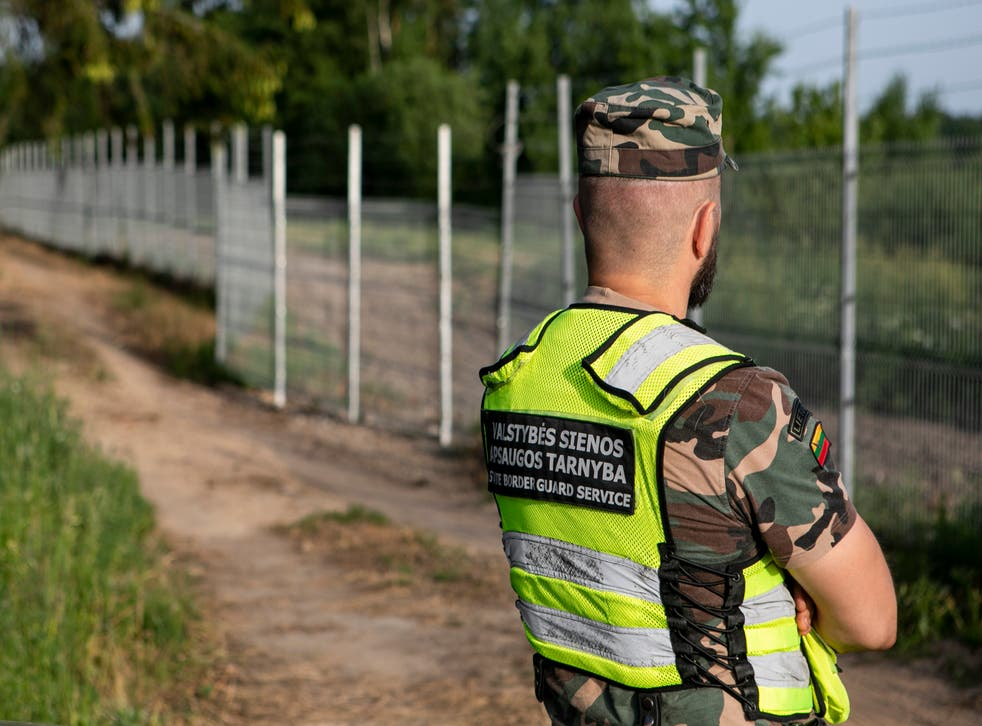 <p>Lithuania State Border guard Vytautas Makauskas on patrol near Poskonys amid an influx from Belarus</p>