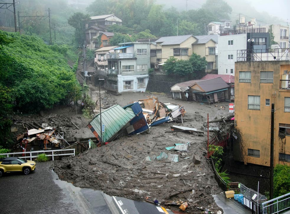<p>Houses are damaged by mudslide following heavy rain at Izusan district in Atami, west of Tokyo</p>