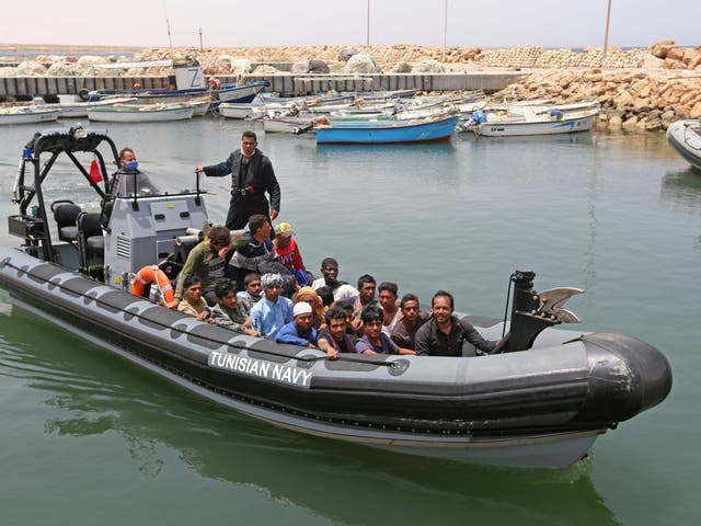 <p>A group of migrants arrive at a port in southern Tunisia  after being rescued during an attempted crossing of the Mediterrean on 27 June 2021</p>