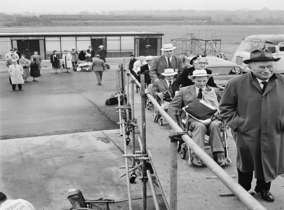 <p>Sir Ludwig Guttmann leads members of Britain's team to Perth for the 1962 Commonwealth Paraplegic Games</p>