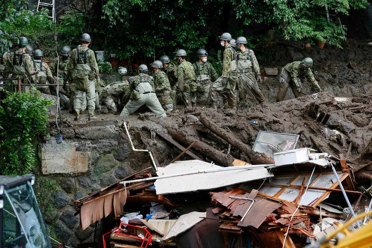 Rescuers slog through mud in Japan resort where 20 missing ...