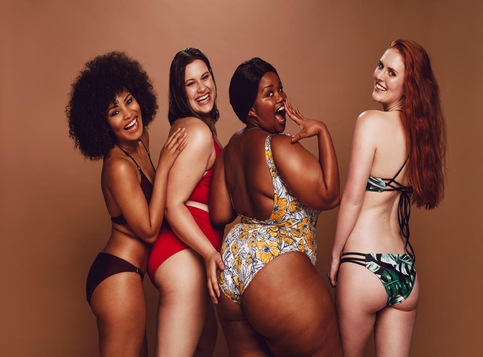 Four women wearing bikinis